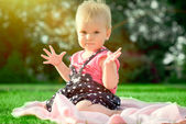 Little girl on the summer meadow — Stock Photo
