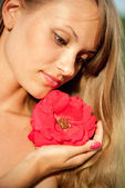 Young sexy girl with red flower #3 — Stock Photo