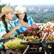 Two young woman gardening — Stock Photo