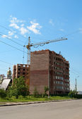 Construction against blue sky — Stock Photo