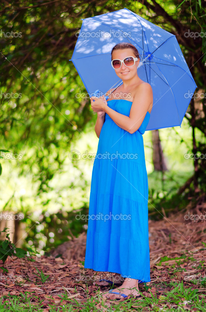 Young woman with umbrella. Outdoor portrait. — Stock Photo #11859438