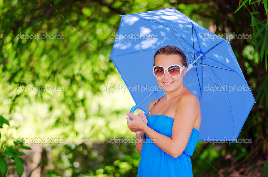 Young woman with umbrella. Outdoor portrait. — Stock Photo #12336528