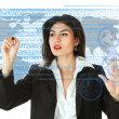 Stock Photo: Young businesswoman working on touch screen