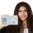 Beautiful young businesswoman with cyberpassport — Stock Photo