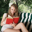 Young woman reading a book — Foto de Stock