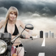 Biker girl on a motorcycle — Stock Photo #11420862