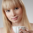 Young beautiful woman with tea — Stock Photo #11600245