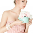 Young woman holding artificial flowers — Stock Photo #11600323