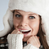 Beautiful young woman in white hat — Stock Photo