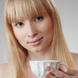 Stock Photo: Young beautiful woman with tea