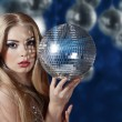 Young woman holding disco ball - Foto de Stock