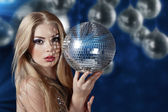 Young woman holding disco ball — Stock Photo