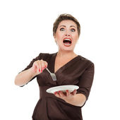 Emotional woman with dish and fork — Stock Photo