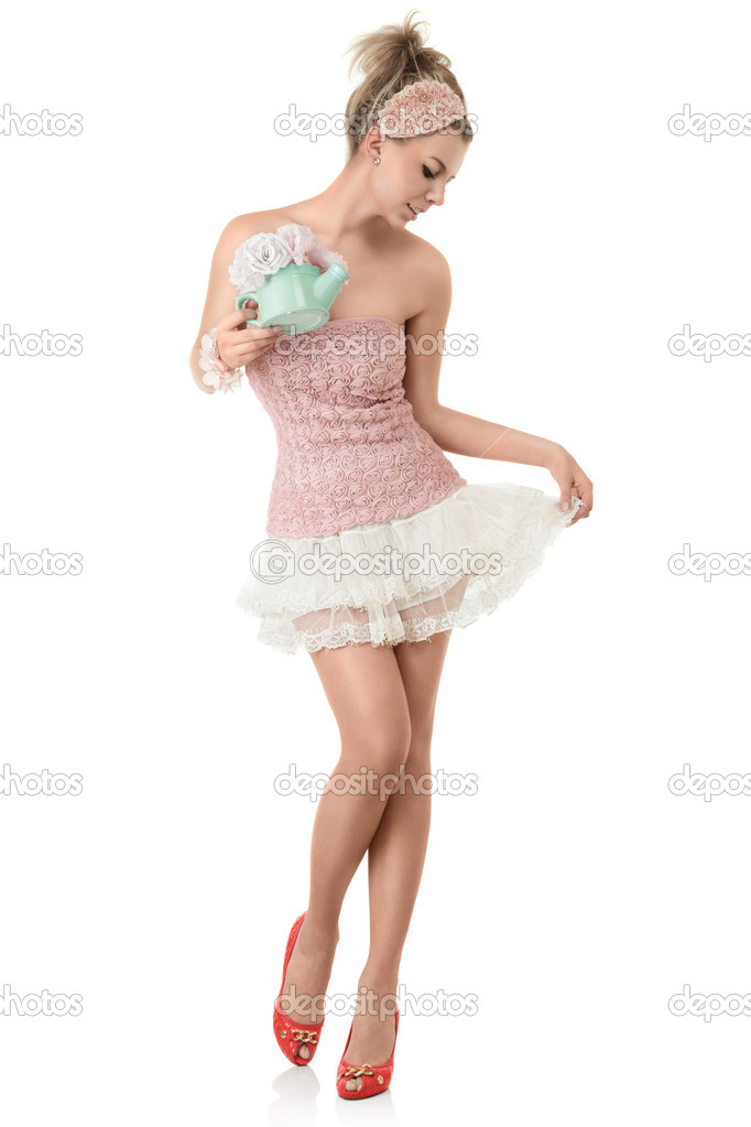 Young fashion model with long sexy legs posing against white background  Stock Photo #12273770