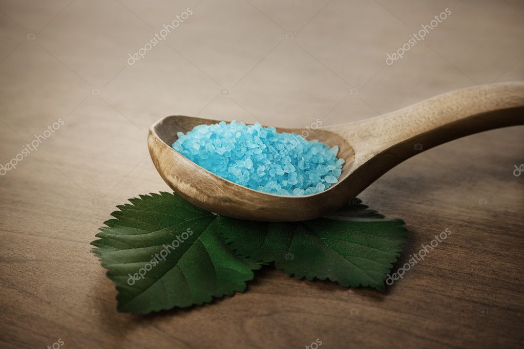 Potion of sea bath salt in wooden spoon — Stock Photo #12273798