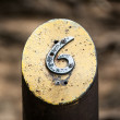 Number Six on a Metal Post — Stock Photo