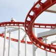 Curve of red and white roller coaster. — Stock Photo