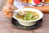 Pork and mushroom congee with dip hand. — Stock Photo