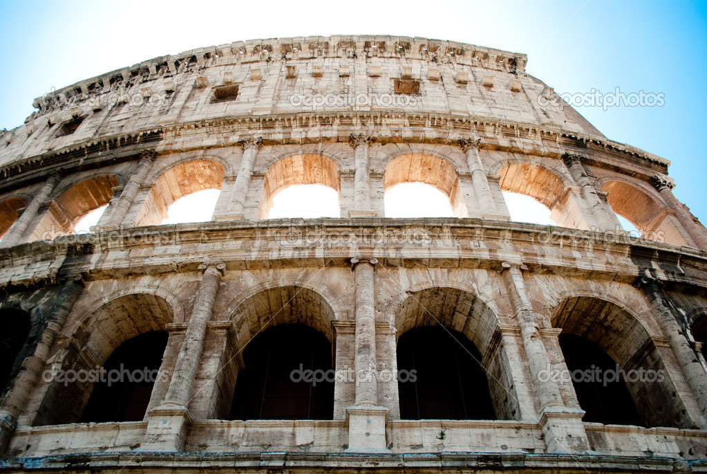 Close-up photo of colosseum with dark one row of windows and bright other one.  Stock Photo #11943546