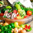 Still life from vegetables and meat on the earthen dish — Stock Photo