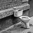 Old dirty toilet in the yard. Black and white — Stock Photo