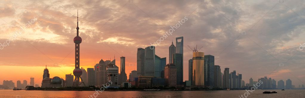 Shanghai morning city skyline silhouette over river — Stock Photo #12103056