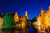 View from the Rozenhoedkaai of the Old Town of Bruges at dusk — Stok fotoğraf