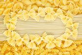 Pasta and farfalle background — Stock Photo