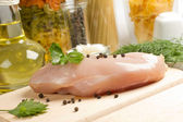Preparation of raw chicken breast — Stock Photo