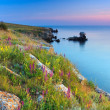 Beautiful rocky sea coast at the sunset — Stock Photo