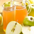 Apple juice and fresh fruits with leaves — Stock Photo #11401396