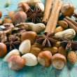 Stock Photo: Aromspices. Cinnamon, anise, peanuts, almonds, cardamom, hazelnuts on vintage wooden surface.
