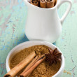 Cinnamon and anise on the vintage wooden surface - Stock Photo