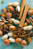 Aroma spices. Cinnamon, anise, peanuts, almonds, cardamom, hazelnuts on the vintage wooden surface. — Stock Photo