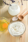 Basic ingredients for dough. Milk, eggs and flour. — Stock Photo