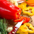 Fresh yellow and red pepper on the wooden board — Stok fotoğraf