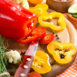 Fresh yellow and red pepper on the wooden board — Foto de Stock