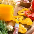 Stock Photo: Fresh yellow and red pepper on the wooden board