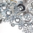 Stock Photo: Two spanners on nuts and bolts