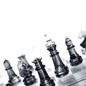 Closeup of glass chess pieces. Copy space — Stock Photo