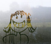 Face in condensation — Stock Photo