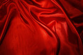 Closeup of rippled red silk fabric — Stock Photo