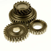 Three metal cogs on plain background — Stock Photo