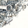 Wrench, nuts and bolts on plain background - Stock Photo