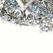 Wrenches, nuts and bolts on plain background — Foto de Stock