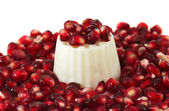 Pomegranate seeds with a white fresh cheese — Stock Photo