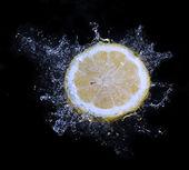 Lemon water splash — Stock Photo