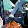 Stock Photo: Thief stole purse from car