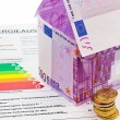 House from € banknotes and energy performance certificate — Stock fotografie