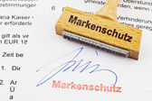 Wood stamp on the document: brand protection — Stock Photo